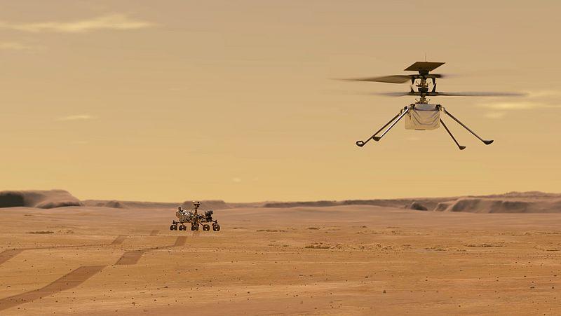 Een helikopter boven de Perseverance op Mars